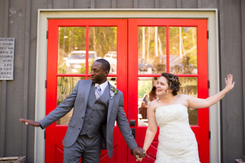 Sugarboo Farms bride and groom with red door