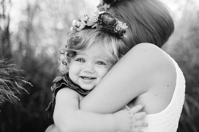 Mother and Daughter in Flower Crowns Hugging Black and White Photo | www.hannahandrandall.com
