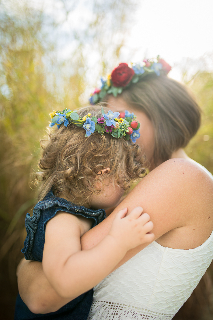 Mother and Daughter in MatchingColorful Flower Crowns at Sunset | www.hannahandrandall.com